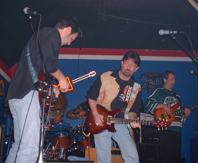 Kirk Mark and Dan on stage at R&R 12-14-02